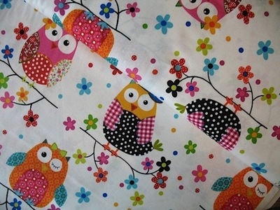 Stof owls on a date on white