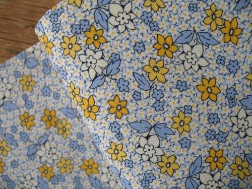 Judie Rothermel Aunt Grace miniatures daisies in blue and yellow of below a