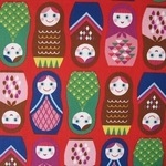 Kokka Happy Russian dolls on red