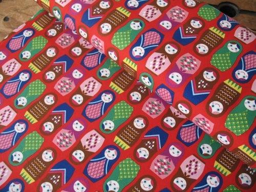 Kokka Happy Russian dolls on red