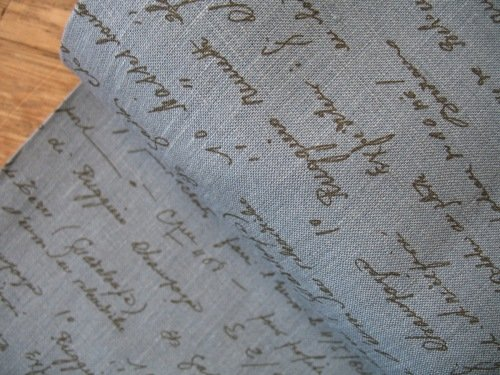 'La Couture' handwritten script in red pure linen on diesel blue (WIDE)