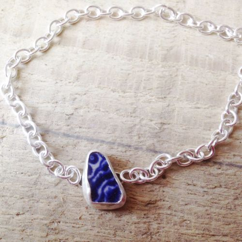 Lovely sea pottery bracelet in a blue and white pattern. Set in sterling si