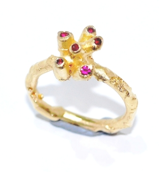 Handmade and unique 18 carat gold ring set with ruby gemstones