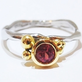 handmade unique ruby gemstone engagement ring, quirky and organic style by jewellery designer Nikki Galloway