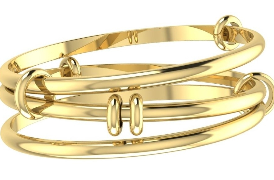 A handmade 18 carat yellow gold bangle