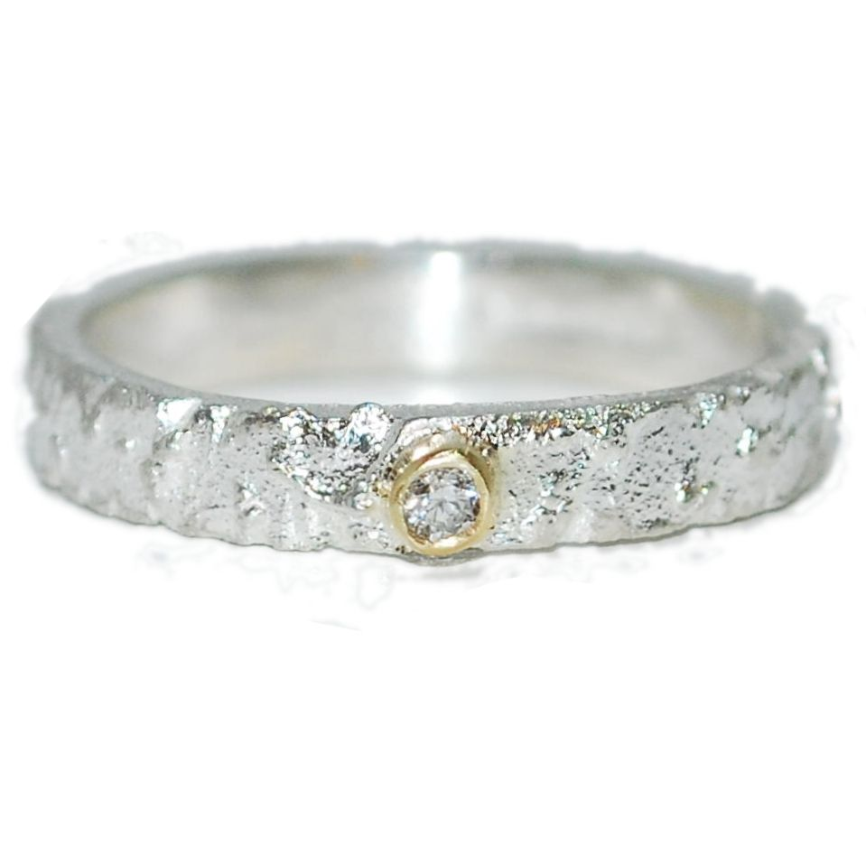 Slim unique textured silver ring with dainty diamond detail.