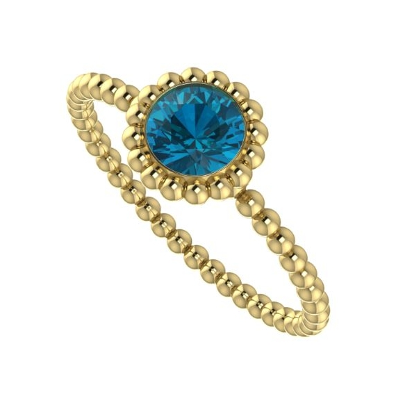 yellow gold and london blue topaz ring