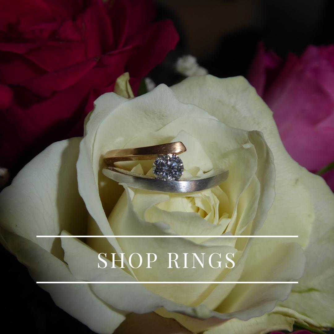 Shop Rings - rose and white diamond tension set ring