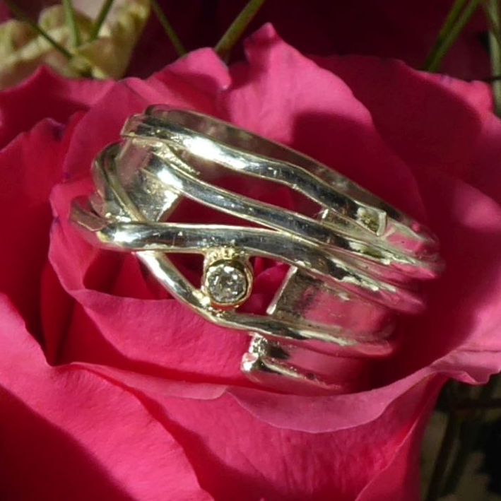 Alternative gold and silver diamond engagement ring