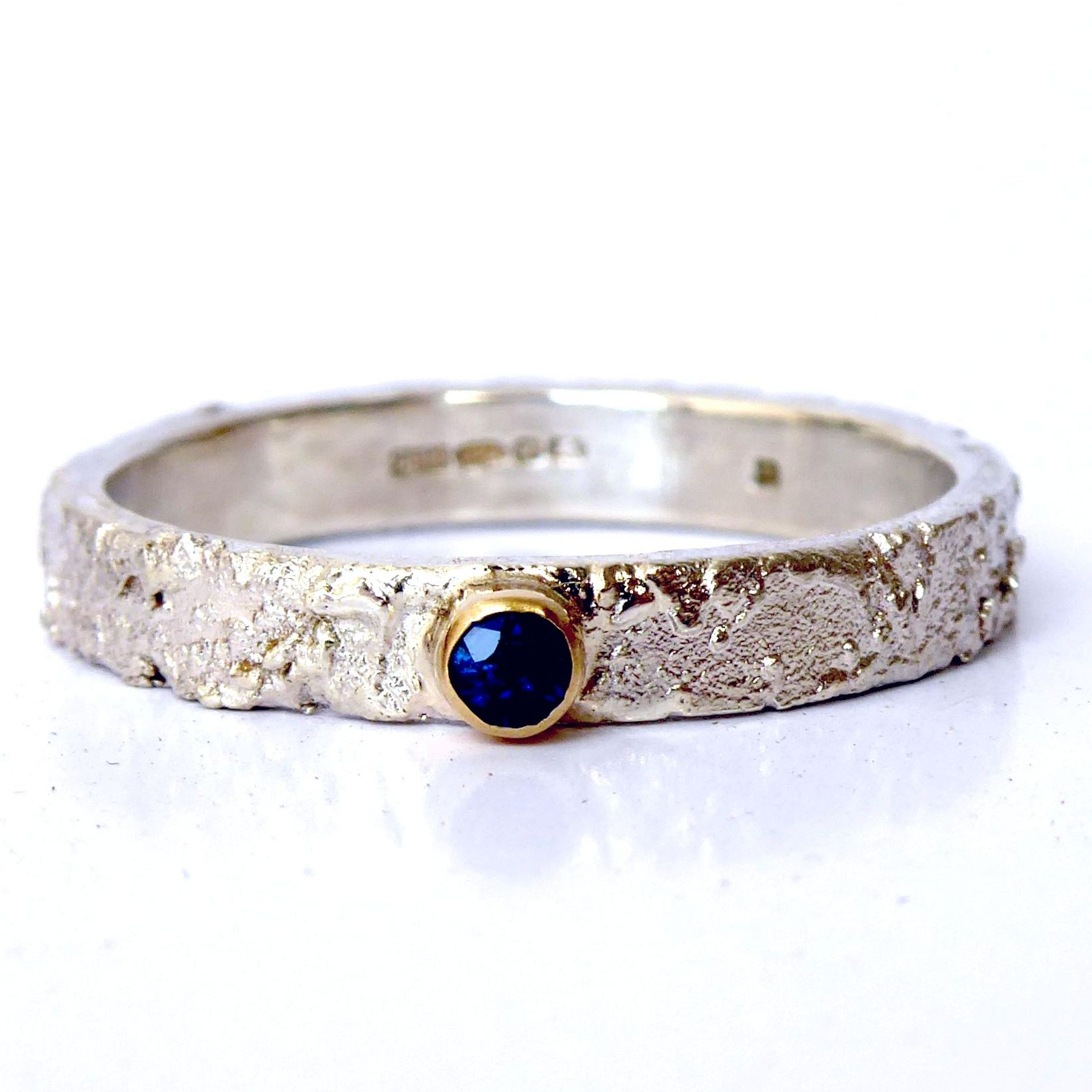 Unusual textured sapphire, silver and gold ring
