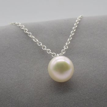 White pearl pendant on a delicate silver  or gold chain. 9-10 mm