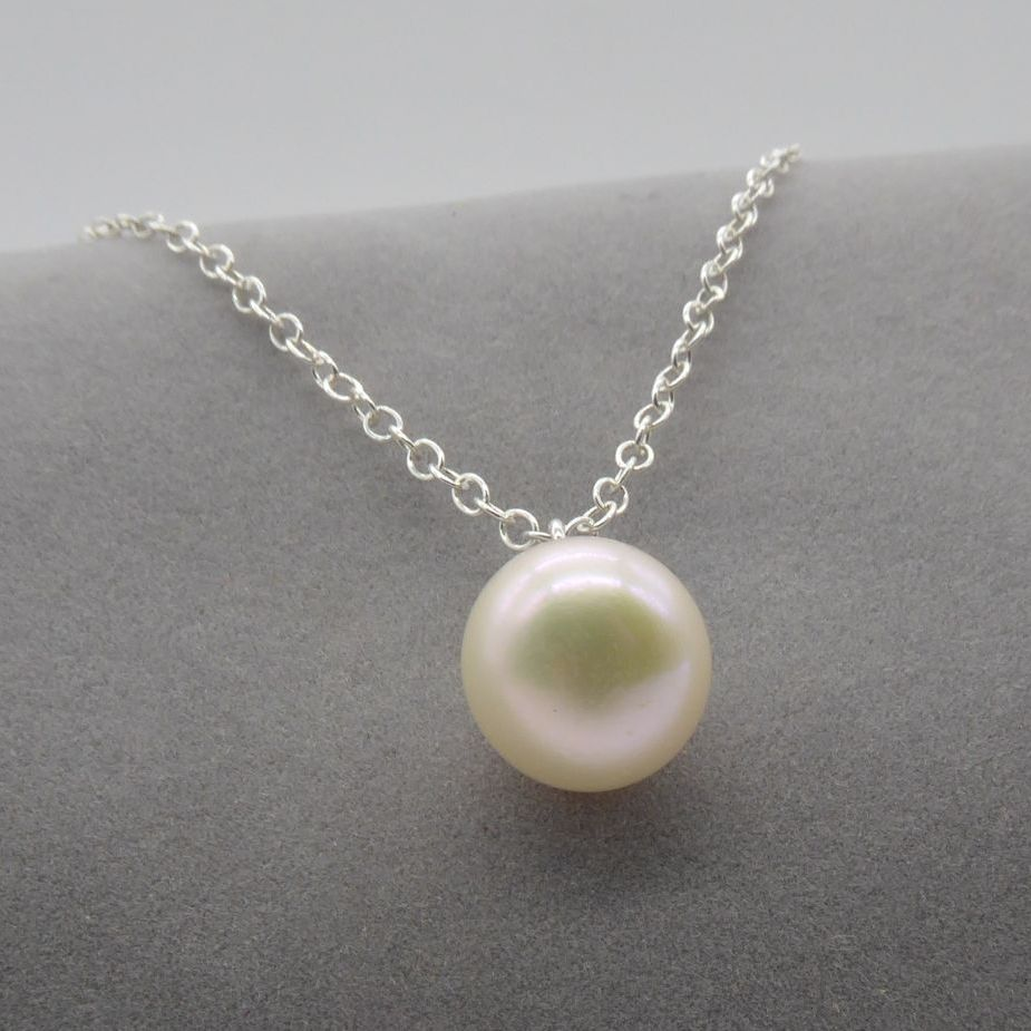 White pearl pendant on a delicate silver chain. 9-10mm
