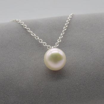 White pearl pendant on a delicate silver or gold chain. 11-12 mm