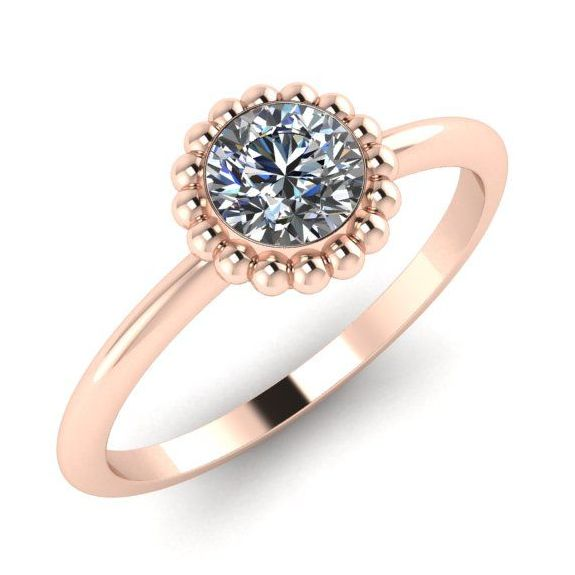 Contemporary rose gold and diamond solitaire ring