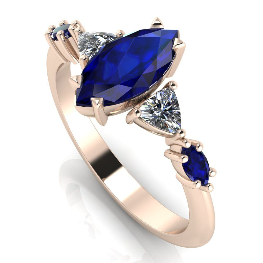 Modern marquise sapphire and diamond rose gold engagement ring