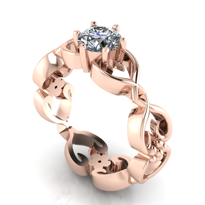 A luxurious and ornate floral solitaire diamond, rose gold engagement ring.