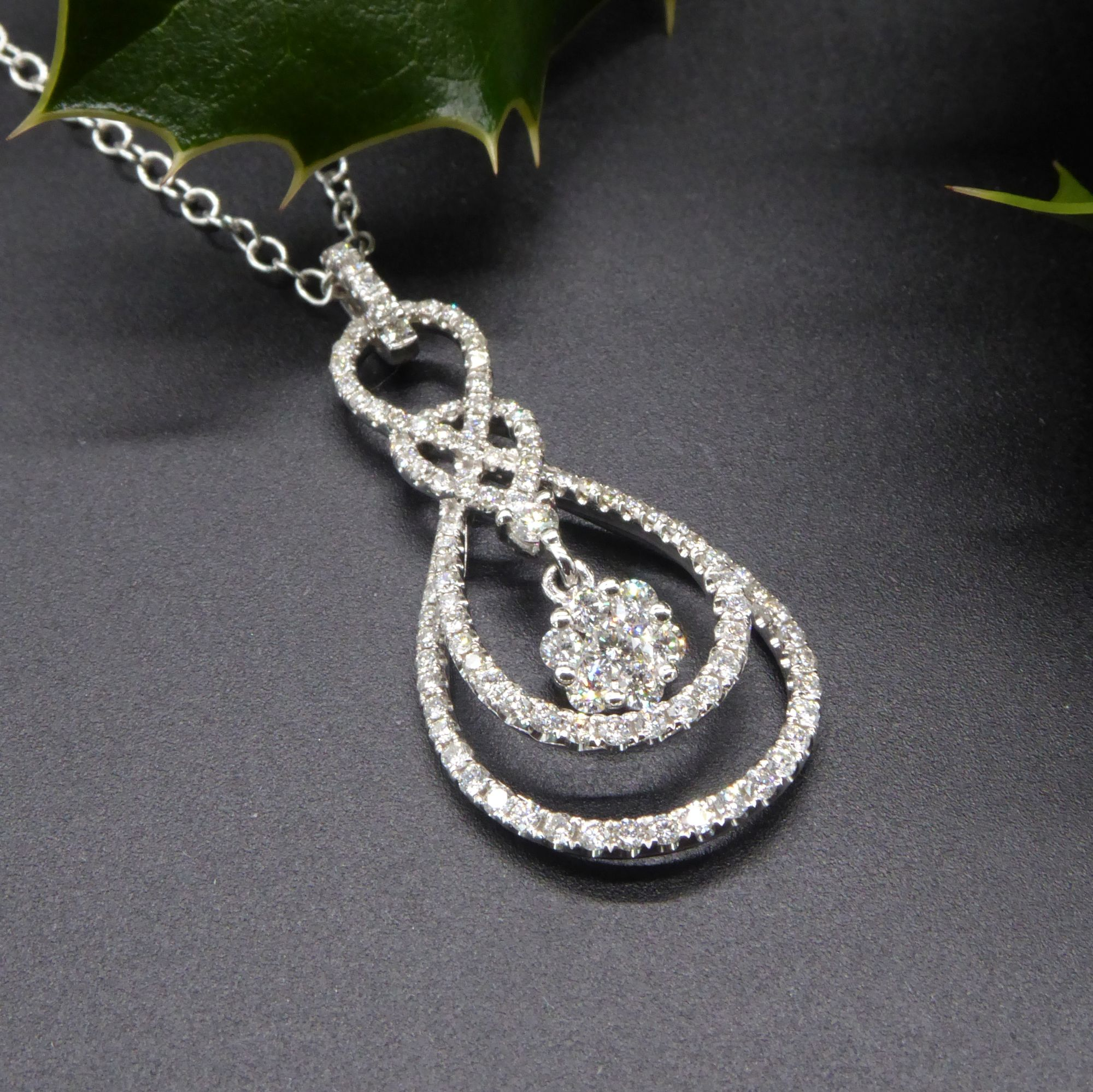 Concentric drop diamond pendant