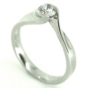 contemporary tension set diamond engagement ring by jewellery designer Hans Rivoir, white gold and simple design