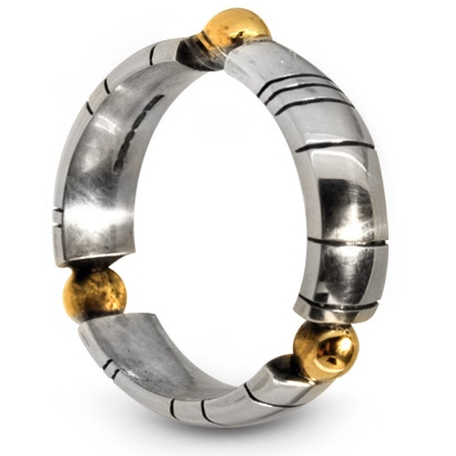 silver and gold detailed ring