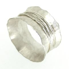 Unusual and quirky handmade silver wedding band
