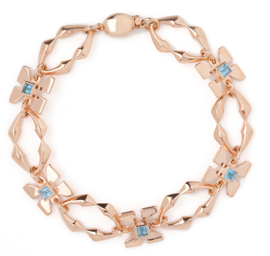 firefly bracelet by jewellery designer Faye Marie, rose gold with blue topaz