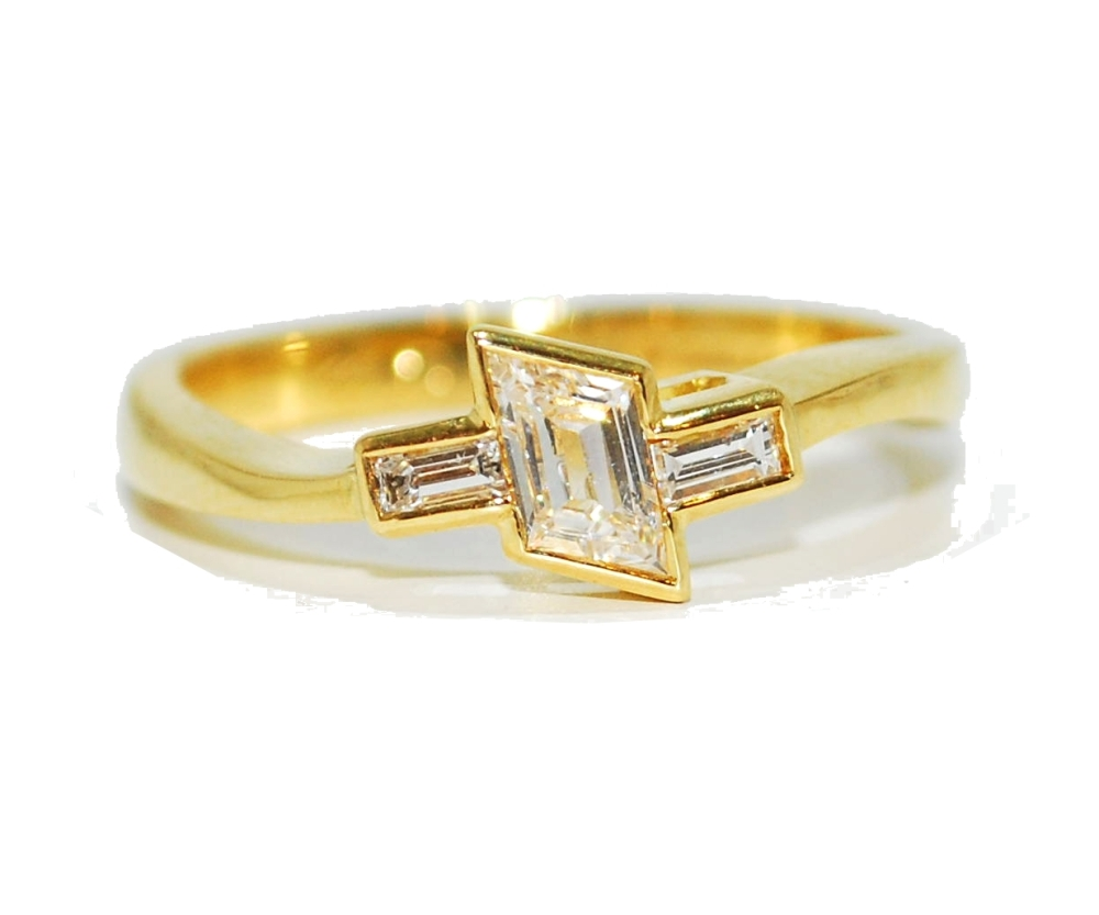 Asymetrical yellow gold unusual diamond engagement ring