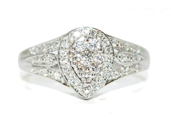 Diamond encrusted pear shape engagement ring