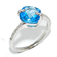 blue topaz gemstone and diamond unusual and quirky engagement ring