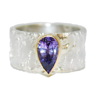 purple sapphire gemstone engagement ring, handmade and unique, a modern, contempoary textured.