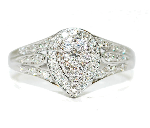Unusual pear shape diamond encrusted engagement ring, white gold