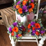 Vibrant wedding bouquets. Purple and orange