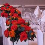 Orange Mirrored Vases Along Top Table