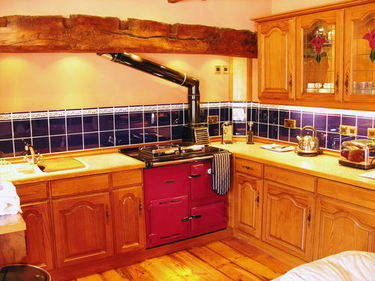Cottage Kitchen with oil fired Rayburn