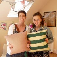 Learn to Use a Sewing Machine course - mother and daughter sewing cushions