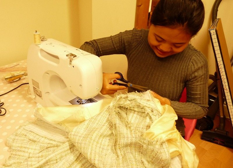 sinta trimming the seam allowance on her jacket seams