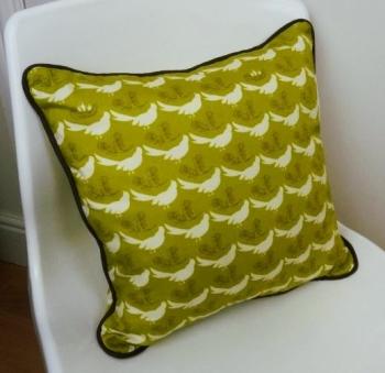 Cushon design piped cushion on chair