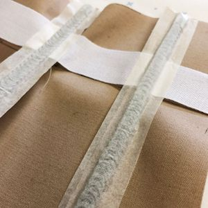 putting corset bones in a corset toile with masking tape