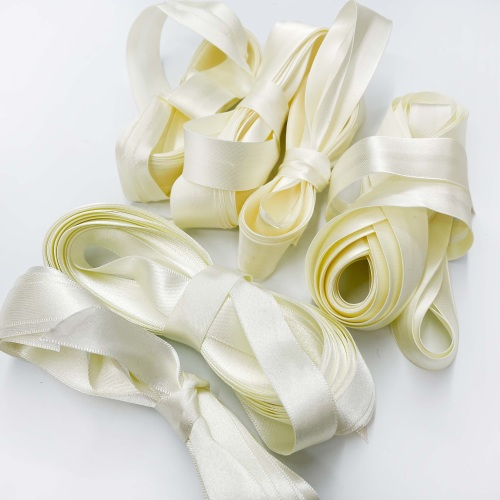 Ivory ribbons and bindings