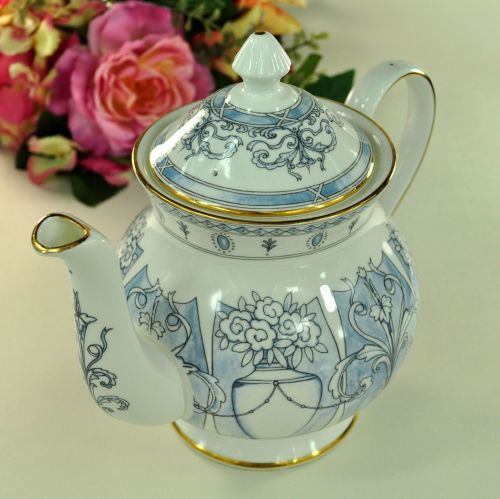 Curvy Urns and Scrolls on a Blue Wash Background