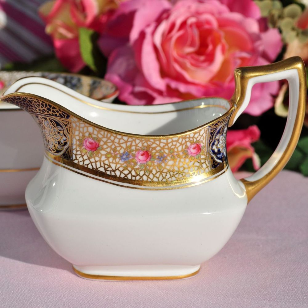 Elegant shaped creamer or milk jug