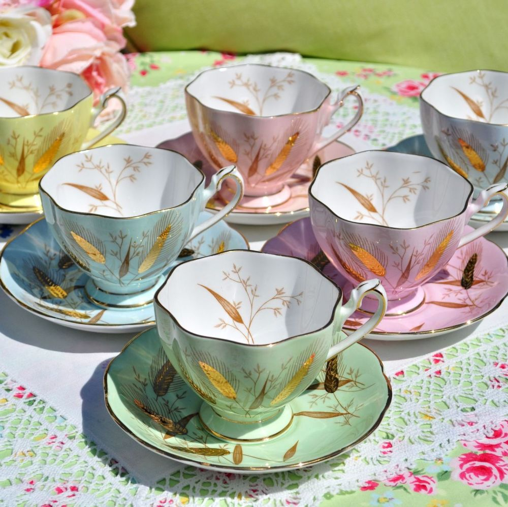 Queen Anne Harlequin Set of Six Pastel Teacups and Saucers