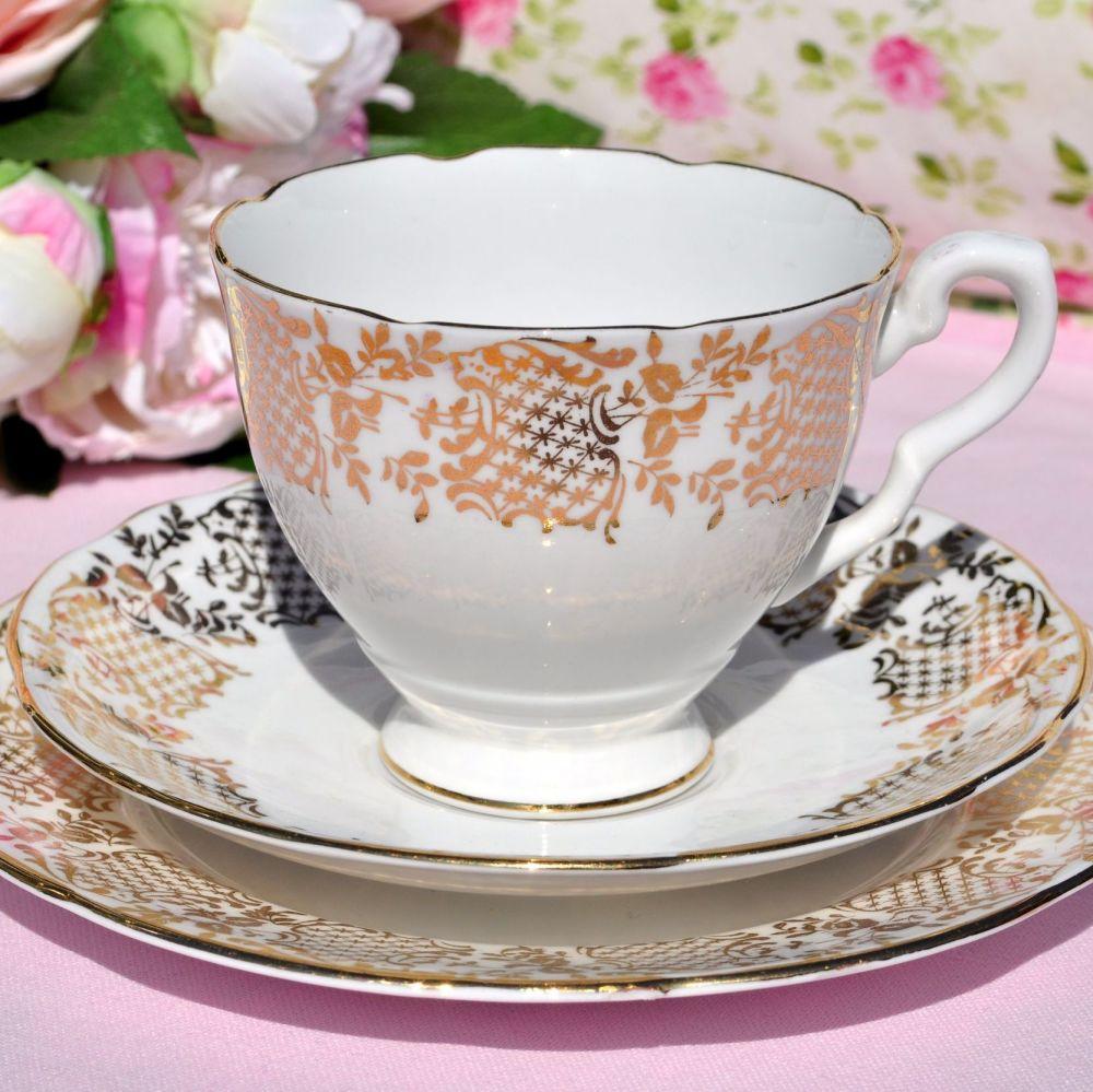 Royal Stafford gold border vintage tea trio