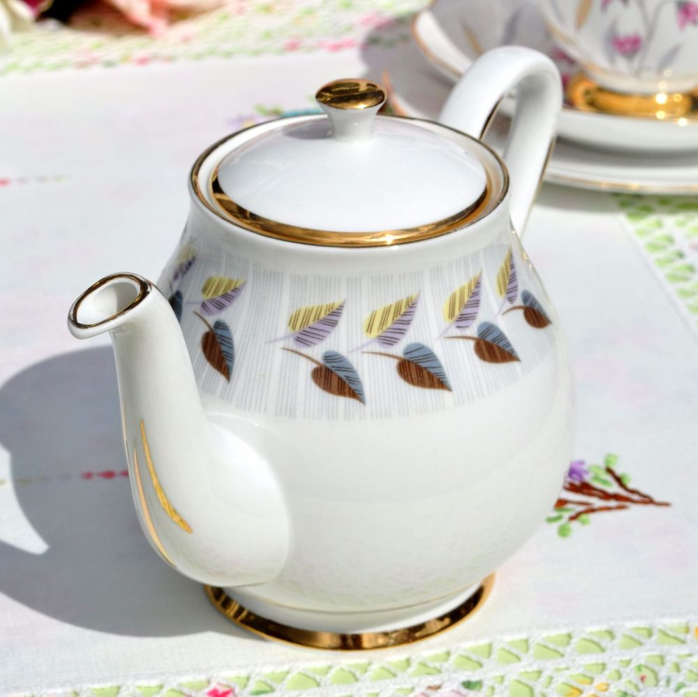 Vintage small teapot with gold