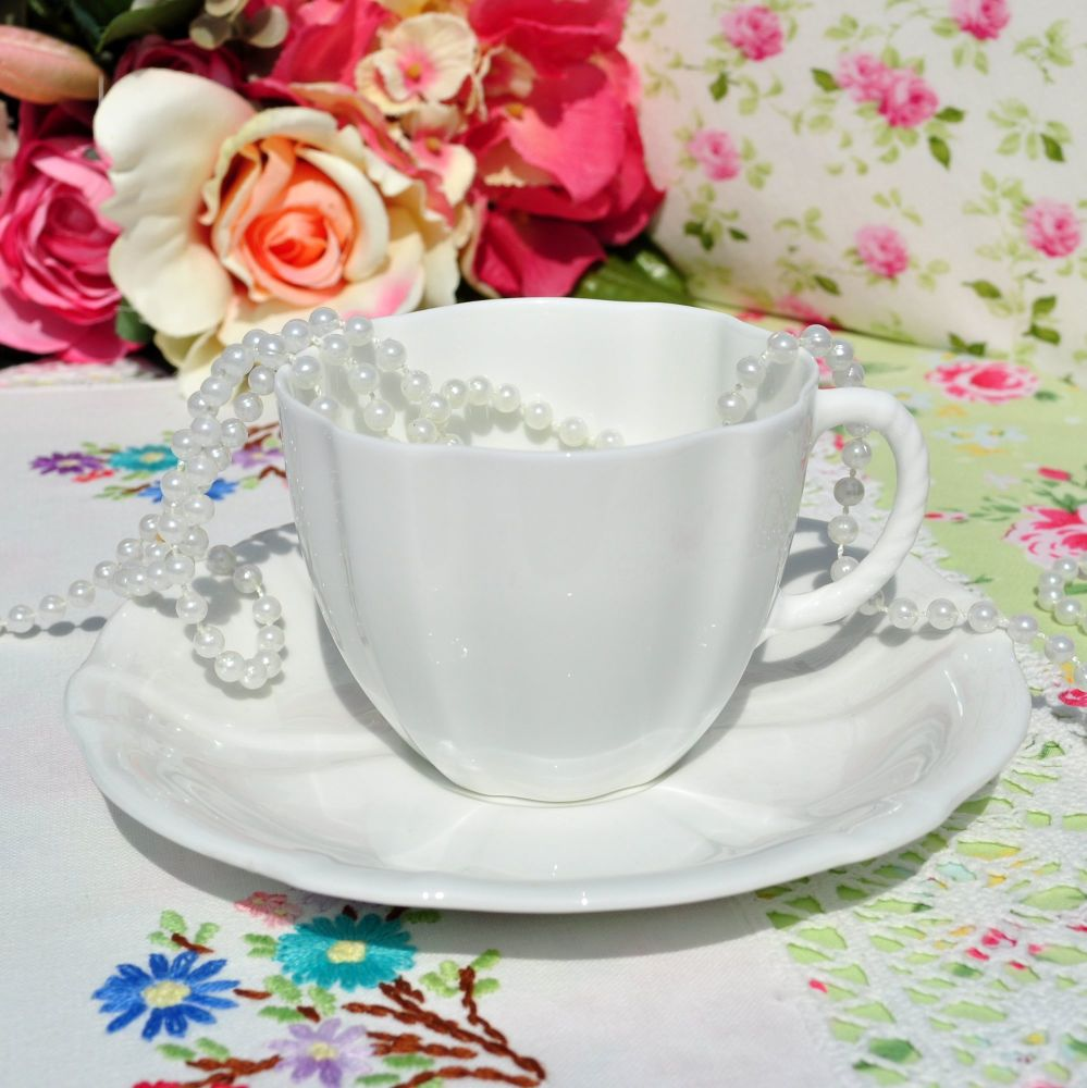 Royal Crown Derby White Glazed China Teacup and Saucer c.1942
