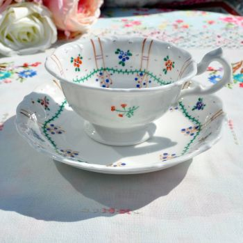 Antique Hand Painted Embossed Teacup and Saucer
