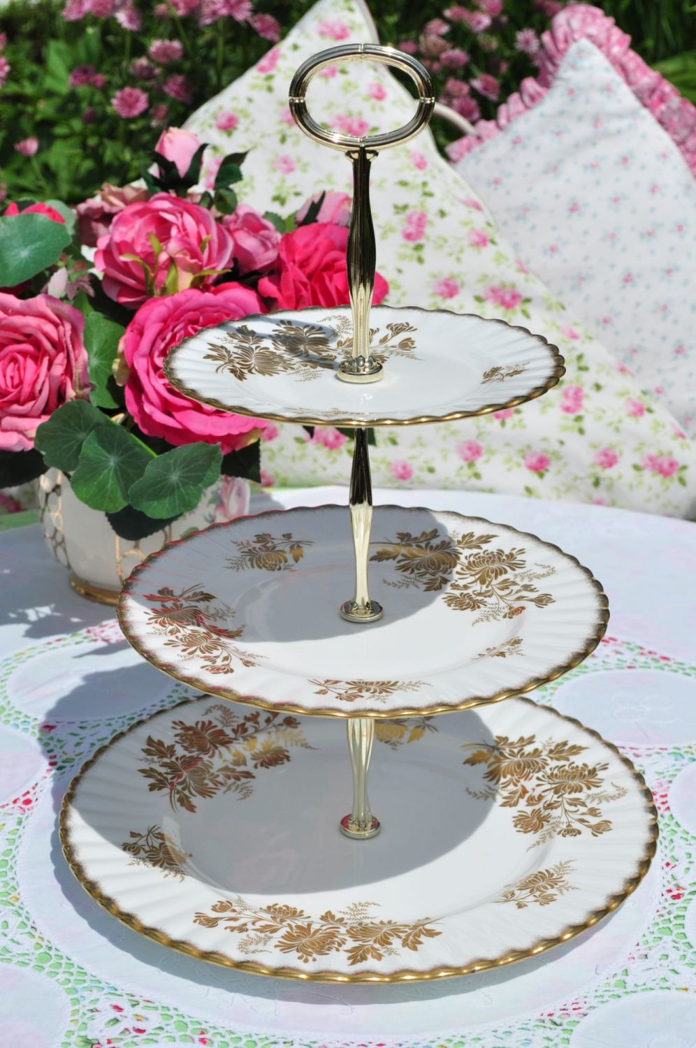 white vintage cake stand with gold floral pattern