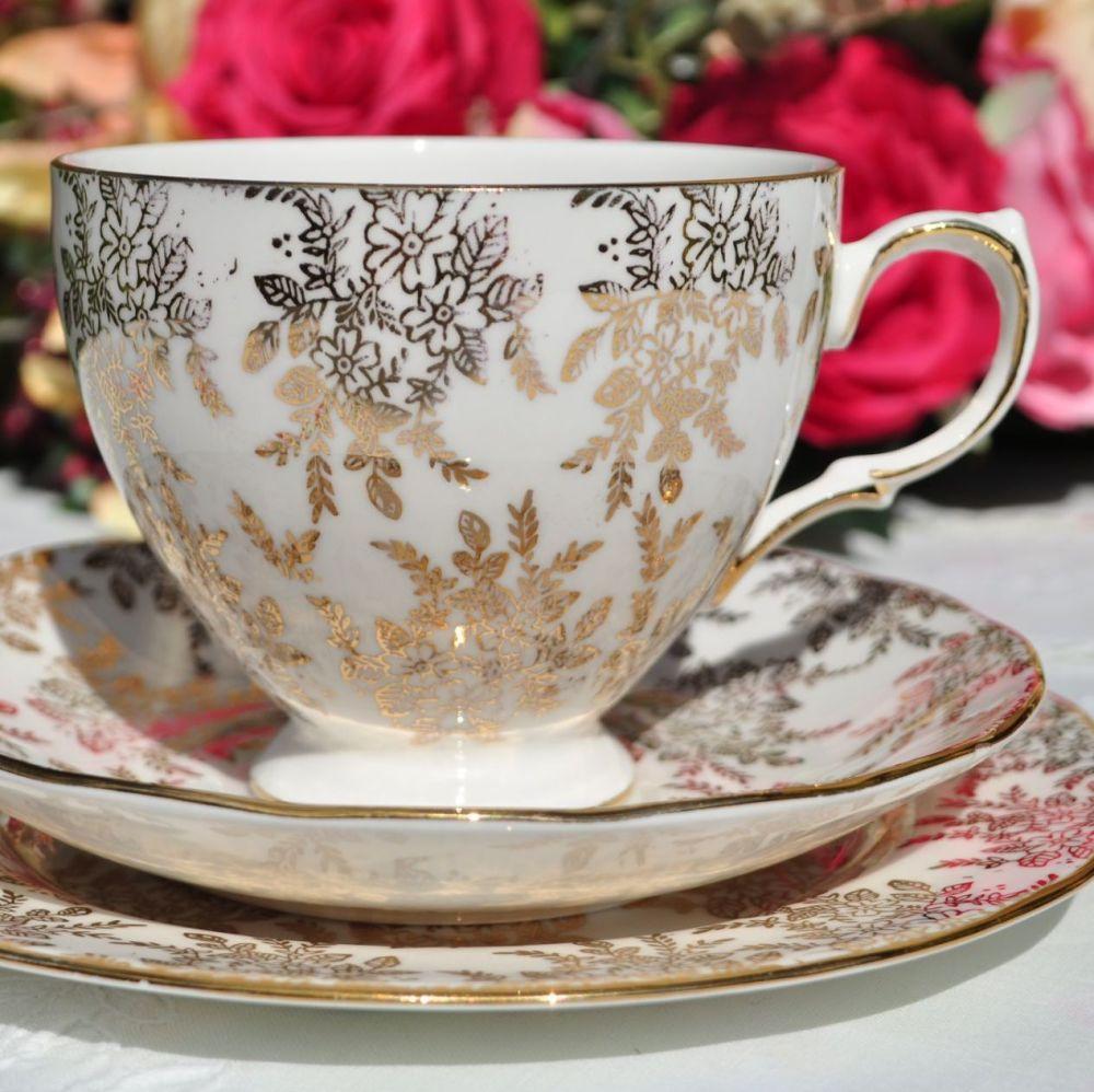 Gold filigree pattern on white china