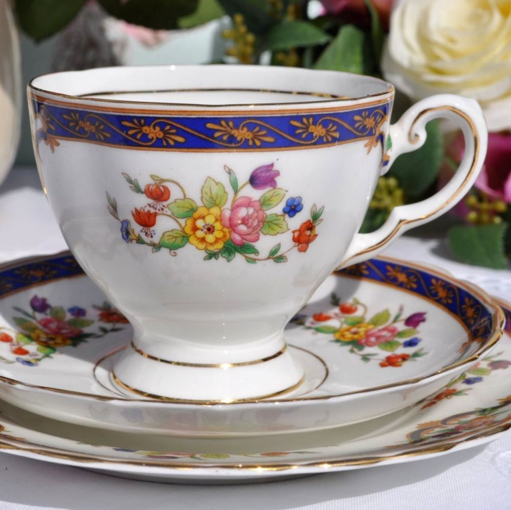 Tuscan Blue Band and Floral Pattern Teacup Trio c.1947+
