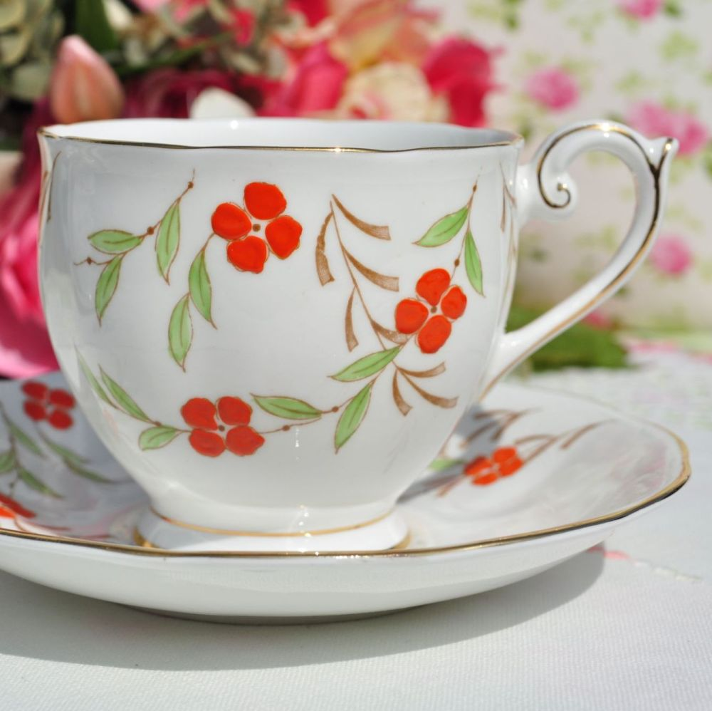 Queen Anne Orange Floral Teacup and Saucer c.1950s