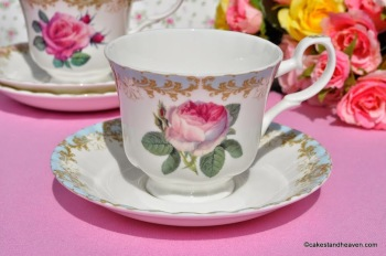 Vintage Rose Blue Rim Teacup and Saucer